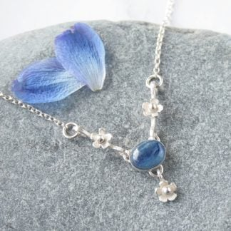 Silver flower necklace with kyanite gemstone by Thistledown Wishes