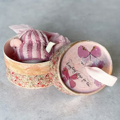 Pink miniature tea cosy on Coalport teapot resting inside its one of a kind gift box