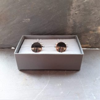 recycled copper cufflinks with grooved texture made by anthea yeo metal art