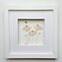 framed picture of 3 white daisies made from tiny shards of ocean smoothed Cornish sea glass