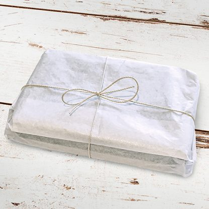 small tin wrapped In tissue paper