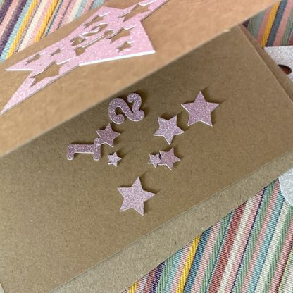 star anniversary or birthday card showing confetti 21 rose