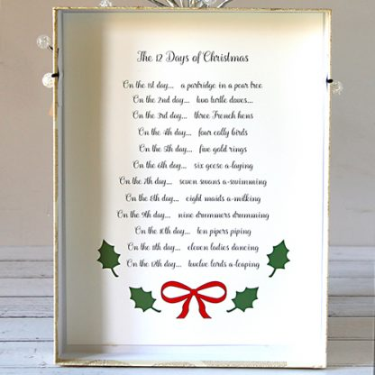 Printed copy of the words of the 12 Days of Christmas song inside lid of presentation box