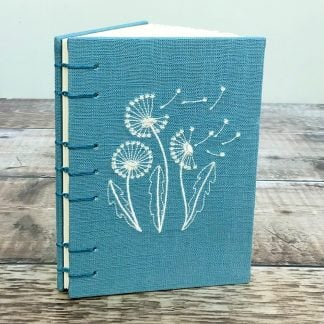 A6 Coptic stitch notebook in embroidered teal linen
