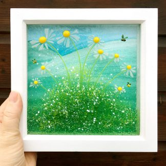 framed daisy art in hand to show size