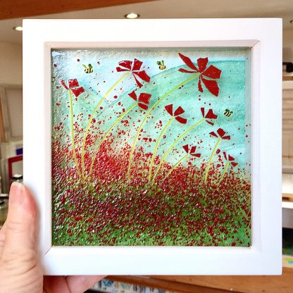 framed poppy art in hand to show size