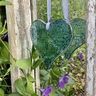 Dappled blue green heart in fused glass with matching ribbon