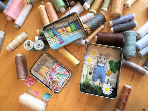 Fabric pictures in tins, little houses and a mouse