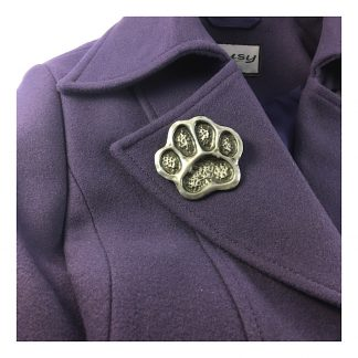 Dog paw print brooch in cold-cast Pewter shown pinned to a purple coat