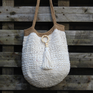 a crochet bag in cream with jute straps
