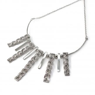 Sterling silver necklace with woven and polished rectangular sections hung from a chain in a sunray pattern