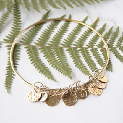 Brass charm bangle by Thistledown Wishes