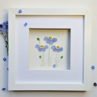 framed picture of forget me nots made with little nuggets of Cornish sea glass