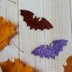 handmade flying bat decorations made from polymer clay in your choice of colours