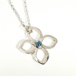 sterling silver flower pendant with blue topaz