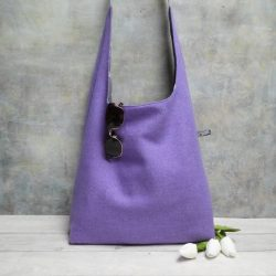 lavender lilac wool large hobo pictured with three white tulips