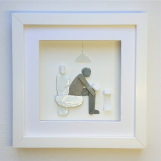 framed pebble art picture of a man on the toilet