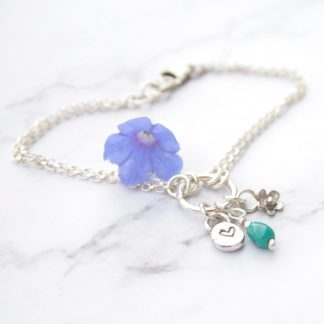 turquoise and silver charm bracelet by Thistledown Wishes