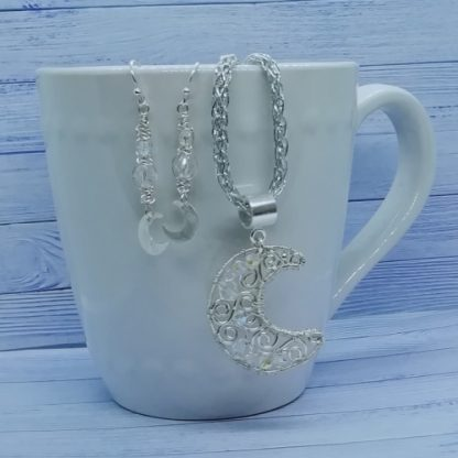 Aurora-Borealis-Wirework-micromacrame-Pendant-and-Earrings-on-a-cup