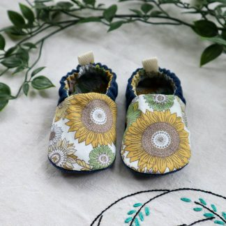 A pair of baby shoes made in a vintage style sunflowers printed fabric