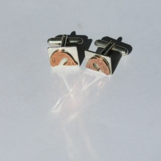 silver cufflinks with copper fish