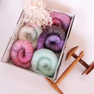 Rolags of dyed wool in a gift box