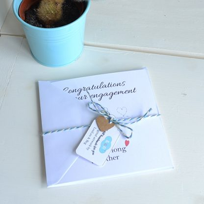 Bees and a beehive on a square card with the words Congratulations on your Engagement - You bee-long together