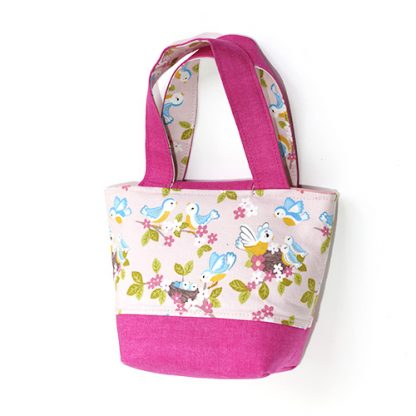 Back view of toddler's toy handbag bag in pink fabric with baby birds