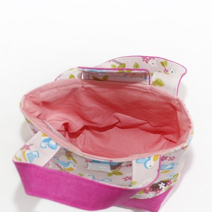 Interior of toy tote bag in baby birds fabric in pink