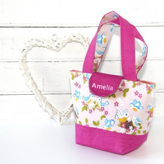 Child's personalised tote bag in pink fabric showing baby birds