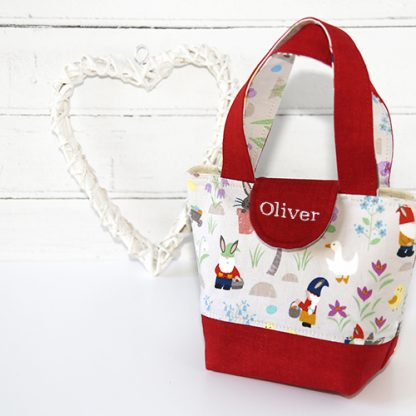 Personalised toy tote bag for toddler in red showing gnomes on print