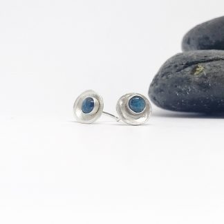 silver earrings with teal coloured gemstone