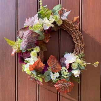 Front door wreath with autumn leaves and greenery