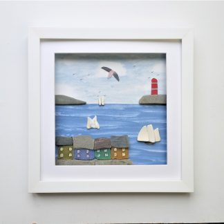 coastal wall decor coloured cottages on harbour wall, lighthouse and sailing boats made from sea glass and sea shells