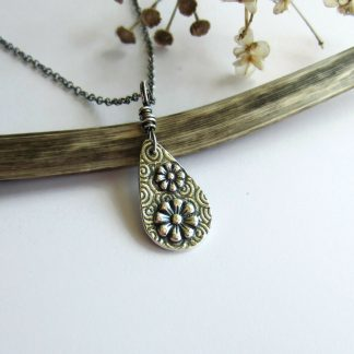 Dainty handmade fine silver daisy teardrop pendant necklace on sterling silver chain, handcrafted by The Tiny Tree Frog Jewellery