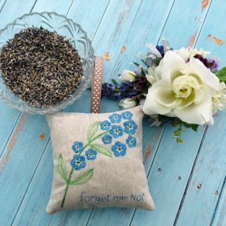 Forget-Me-Not-Lavender Bag Main Photo with lavender and flower props