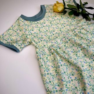 Jersey girls dress in a yellow pink and green floral print