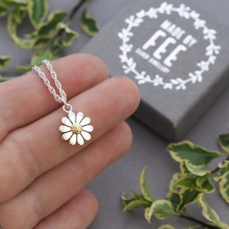 Dainty 12mm sterling silver daisy pendant necklace with 18ct yellow gold centre shown on hand Made By Fee