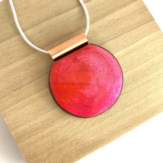 modern bright pink copper and wood circular pendant