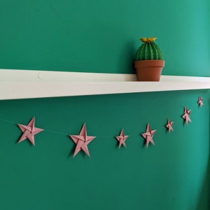 Pink origami star bunting with green paper cactus