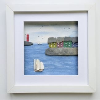 Framed coastal wall decor featuring colourful cottages made from sea glass and yachts made from sea pottery