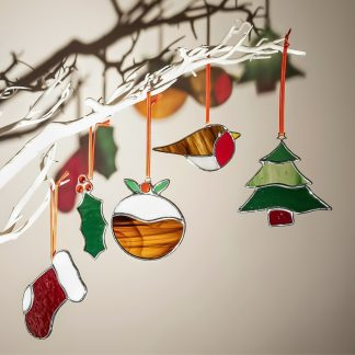 Stained glass Christmas decorations collection on twiggy tree