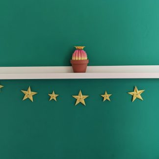 Yellow origami star garland with rainbow ombre cactus