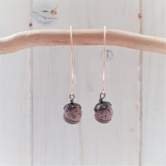 acorn style earrings with recycled copper and mauve coloured lava rock beads