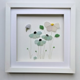 framed picture of flowers made from tiny nuggets of Cornish sea glass