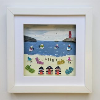 framed picture of beach huts and a crowded summer beach with wind breaks, parasols and windsurfers
