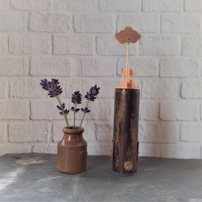 reverse of 'no storm lasts forever' small recycled copper sculpture