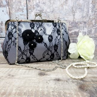 Silver satin evening bag with a black lace overlay