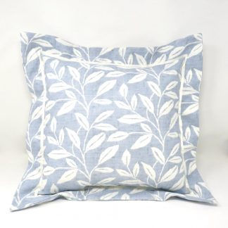 A flanged cushion in a blue and white leaf print