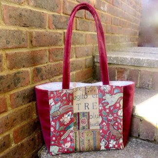 Handmade burgundy tote with medieval style fabric panels